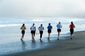 women_jogging_beach